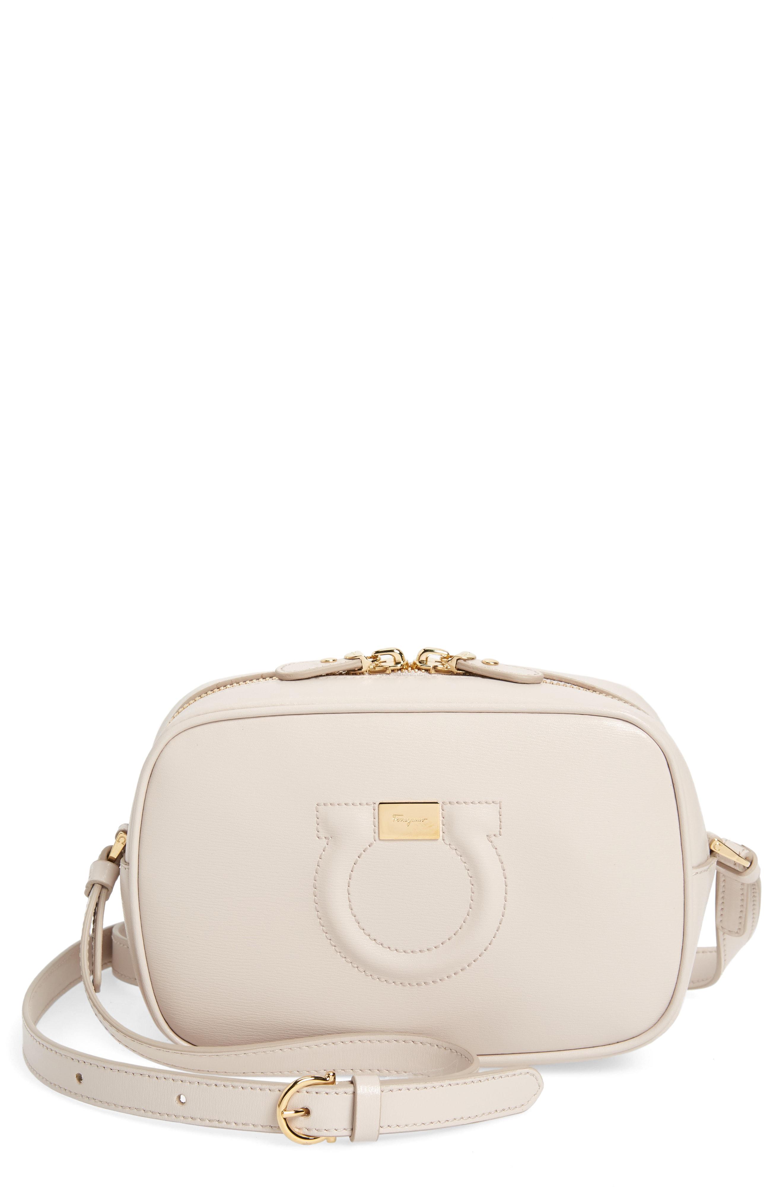 32939c41fa ... this iconic Gancio City camera bag from Salvatore Ferragamo features a  detachable and adjustable shoulder strap