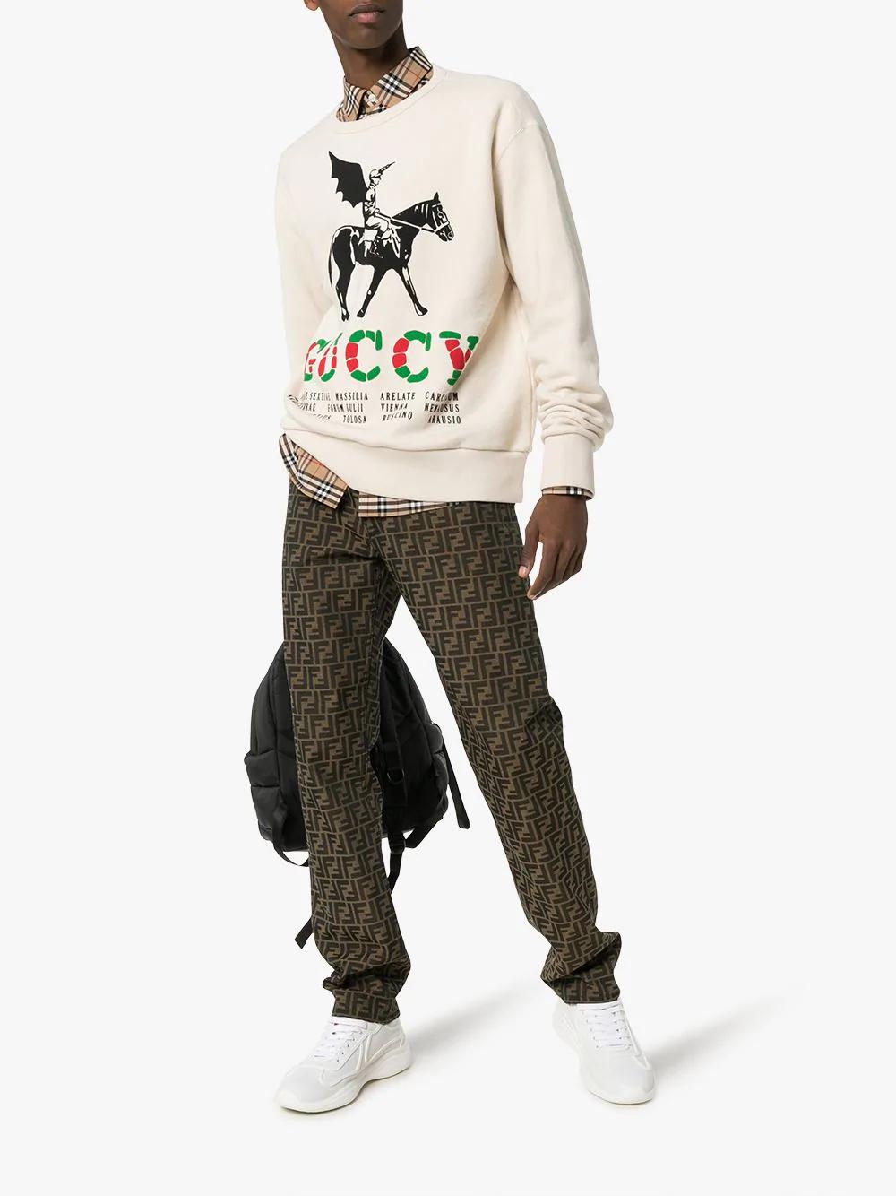 5ea3ea7cf65 Gucci Winged Jockey Guccy Jumper In 9230 Natural White  Multi