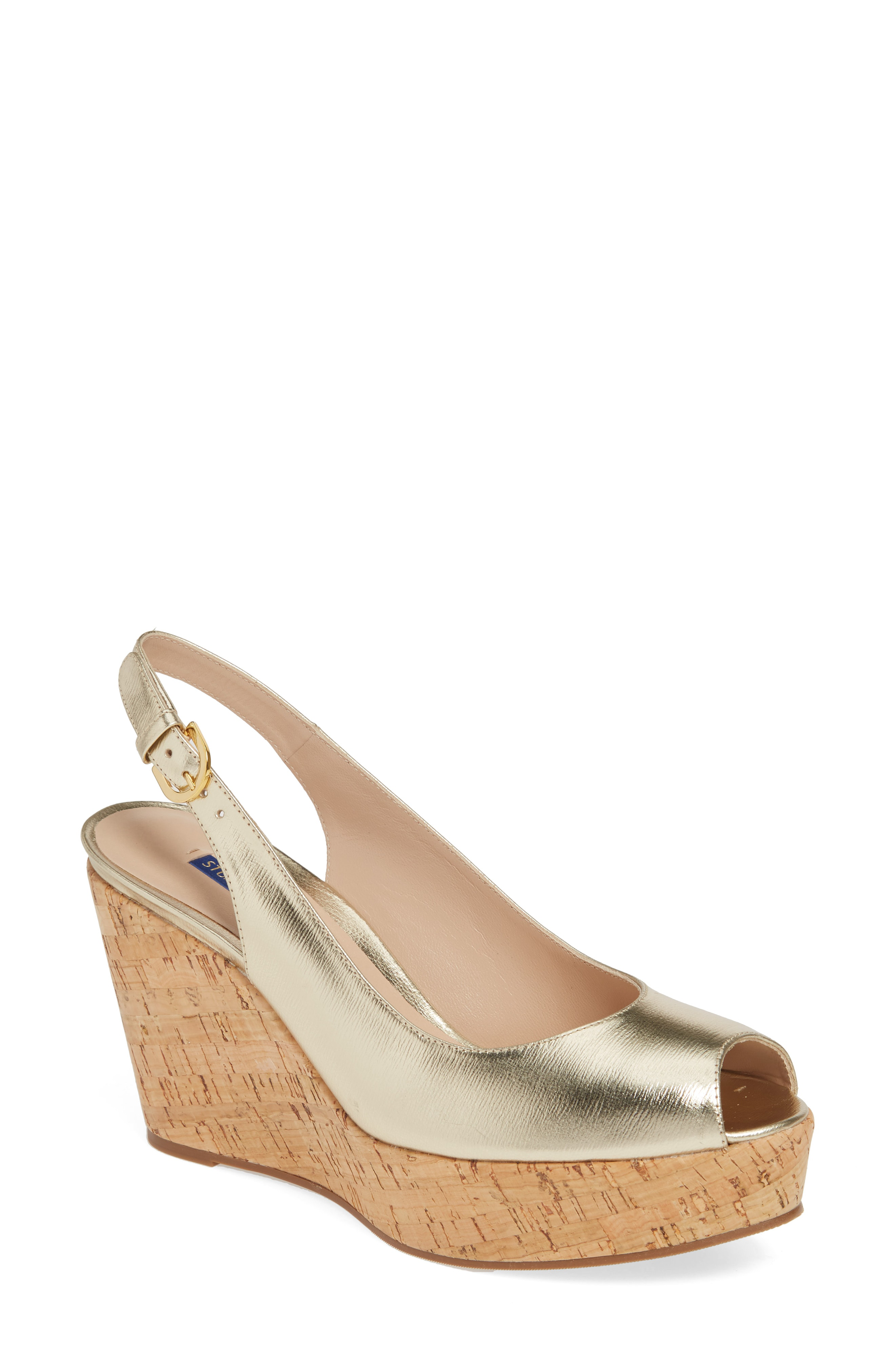 fc2d649c6fe Stitched trim tops the chunky cork wedge of a slingback fashioned with a  flirty peep toe. Stuart Weitzman shoes are favorites among editors