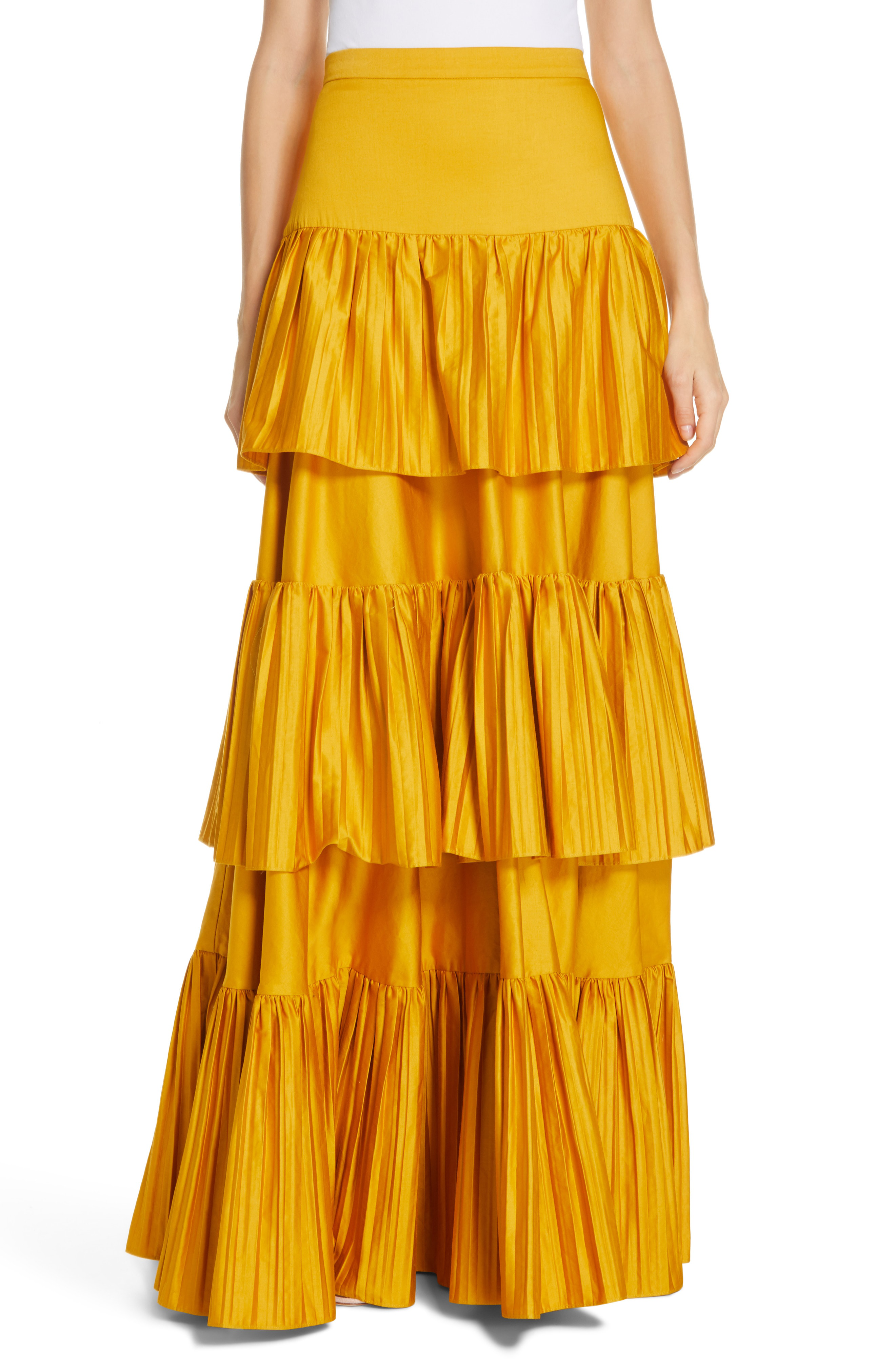 4d189b8d2e57 Pleated tiers playfully flounce from a colorful maxi skirt crafted using  certified organic cotton as part of AMUR s commitment to sustainability.