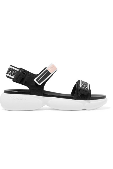 8a91eb5b5aaa35 These sandals are constructed from black leather straps detailed with  knitted inserts and sitting atop Prada s white Cloudbust sole.