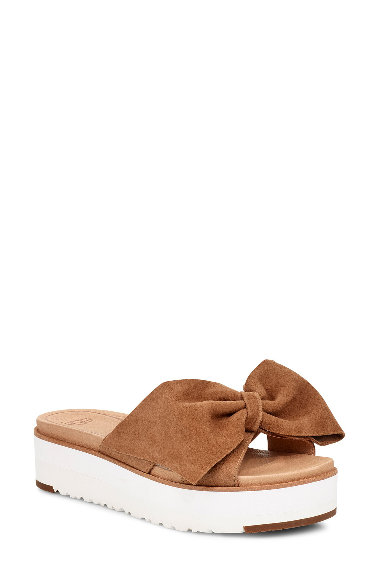 91a327565976 An oversized bow graces the top of a playful slide sandal designed with a cushioned  Imprint by UGG footbed and platform sole.