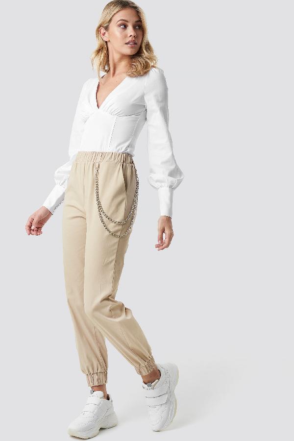 2a4ab7119e3 Anna Nooshin X Na-Kd Chain Detailed Puffy Pants - Beige