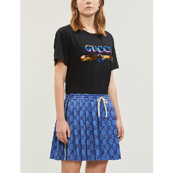 0ffc3cffc42 Gucci Brand-Print Pleated Polyester-And-Cotton Blend Shorts In Pervinca  Multi. Selfridges