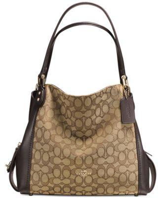 Versatile flat-stitch handles top a multi-season shoulder bag sculpted from  supple leather and luxe jacquard emblazoned with the iconic COACH Cs.  Inside ... e7f8404a9c395