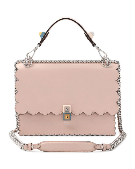 43b61ddf2d27 Fendi s classic Kan I tote bag is back for Spring Summer 18 in this classic  Italian nude calf leather. It features the signature two-tone studded twist  lock ...