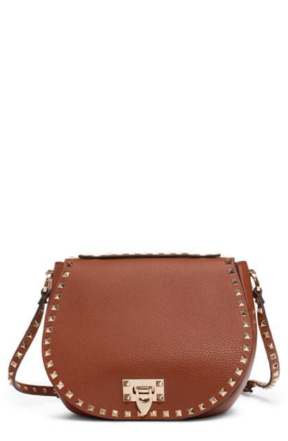 Valentino Garavani Small Rockstud Leather Saddle Bag In Selleria