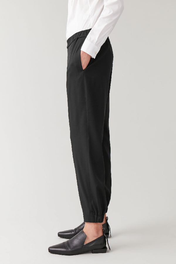 Cos Elasticated Wool-mix Trousers In Black