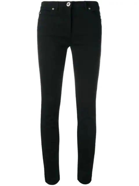 Versace Medusa Embellished Slim Denim Jeans In Black