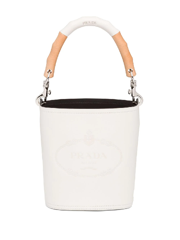 Prada Logo Embossed Leather Bucket Bag In White