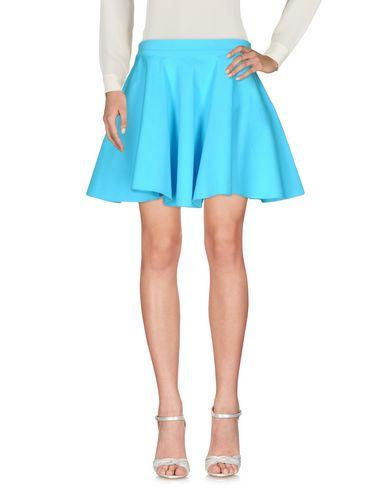 Jeremy Scott Mini Skirts In Turquoise