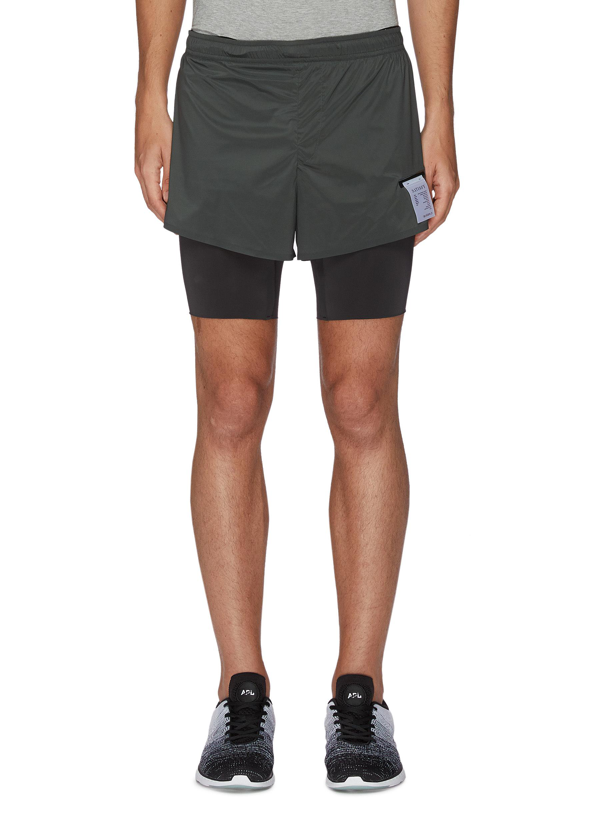 Satisfy Trail Long Distance Eight Inch Underlay Shorts In Green,black