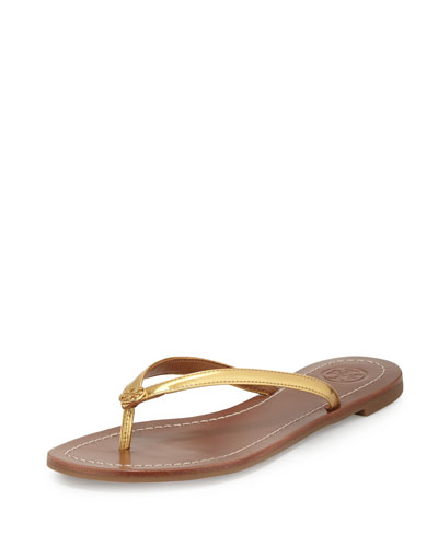 9e43550e228 ... with high-gloss calfskin-leather straps and a logo-embossed footbed.  Leather upper and lining rubber sole. By Tory Burch  made in Brazil. Salon  Shoes.