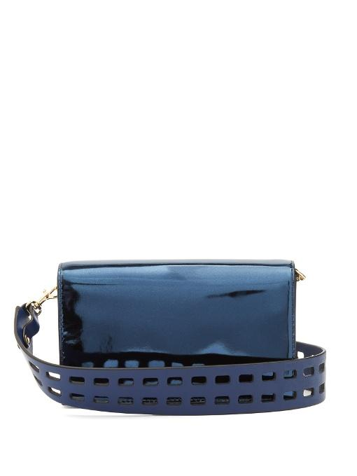 93d75cc7b853 Add a touch of lustre to evening looks with DVF s metallic midnight-blue  Soiree bag. It s crafted from patent leather to a compact shape with neat  pockets ...