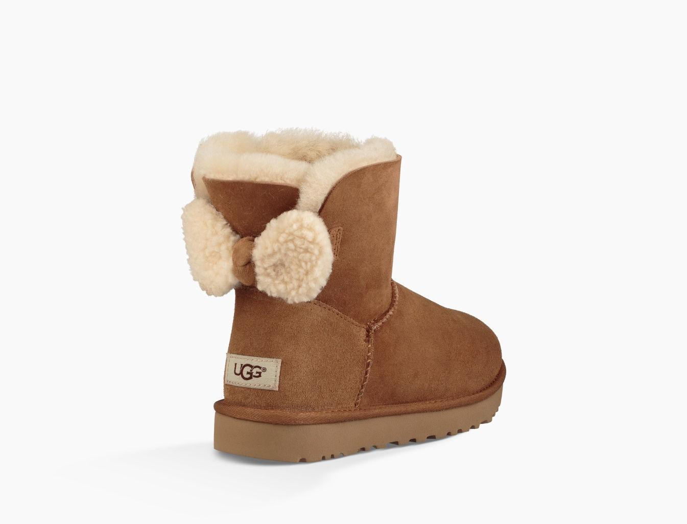 b03af7d249a Stivali Arielle Mini Bow In Shearling Beige in Chestnut Suede