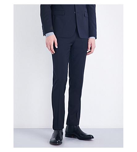 Sandro Tapered Slim-fit Wool Pants In Navy Blue