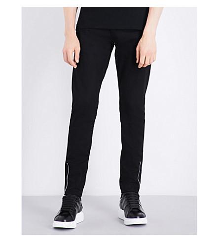 Alexander Mcqueen Zipped-cuffs Slim-fit Tapered Jeans In Black/black