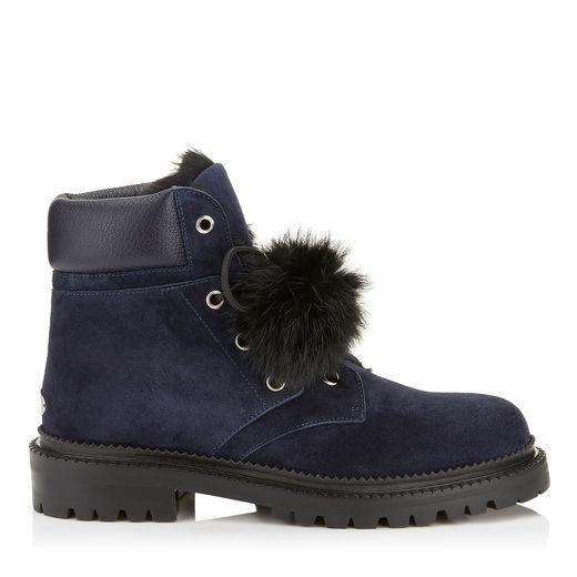 Jimmy Choo Elba Flat Navy Suede Boots With Fur Pom Poms In Blue