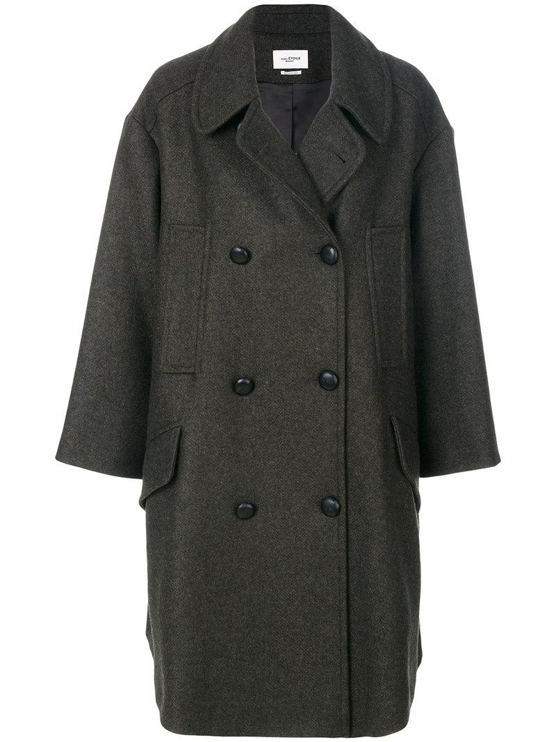 600947f6e8b2 This long pea coat with wide sleeves is decorated with large buttons and  would be an ideal part of a glamorous outfit combined with cigarette jeans