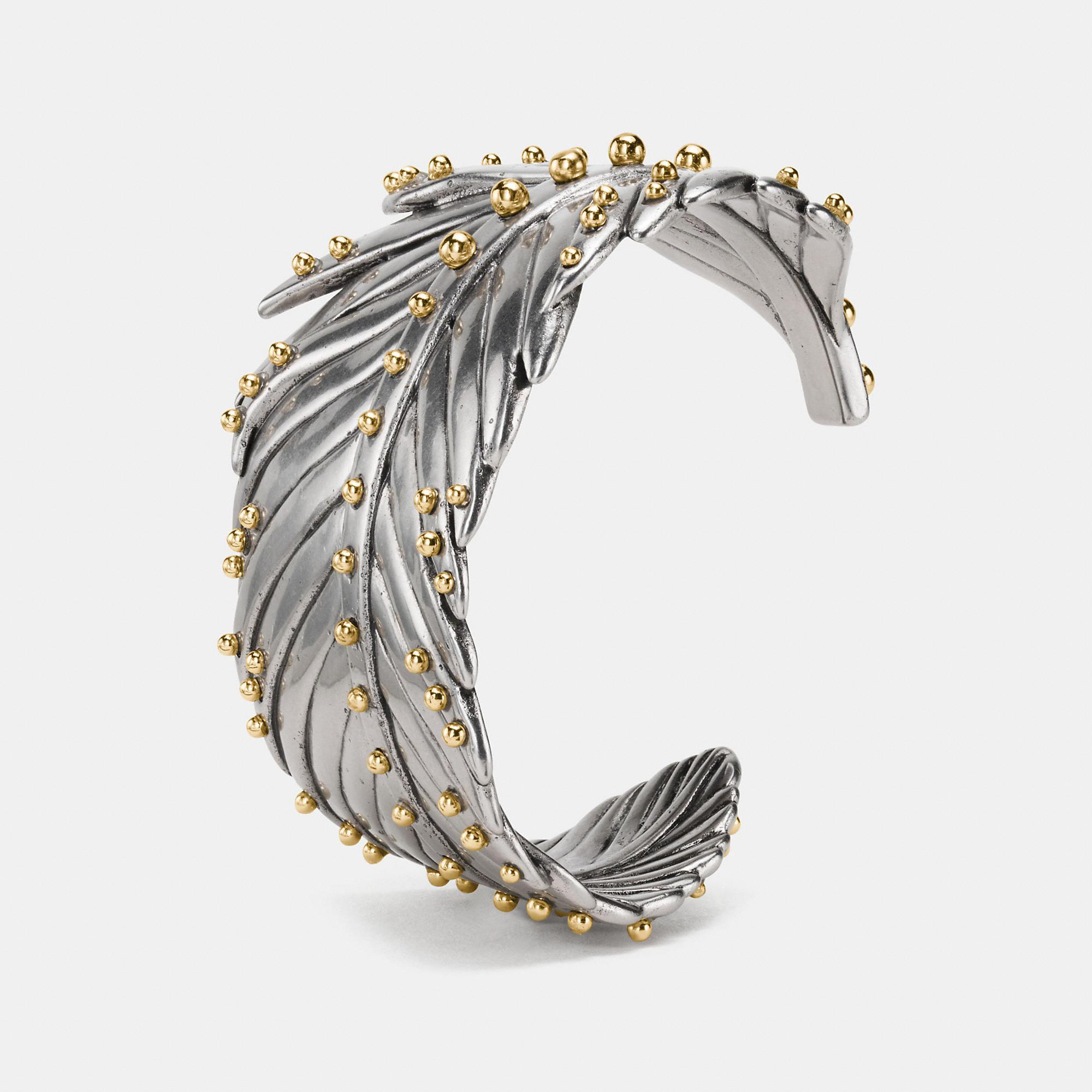 Coach Studded Feather Wrap Cuff In Silver/gold