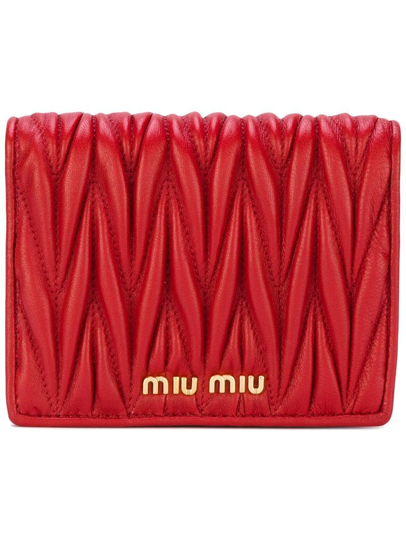 55fb6bac7c9 Miu Miu Matelassé Fold Wallet In Red