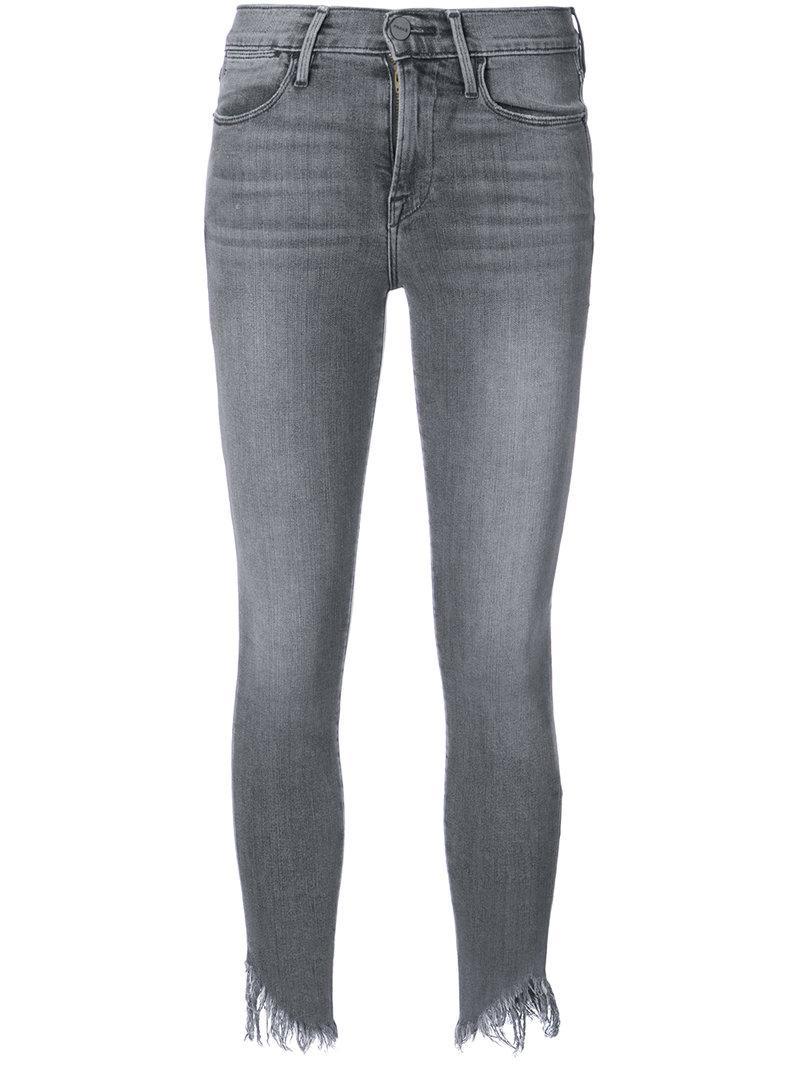 Frame Shredded Hem Jeans In Grey