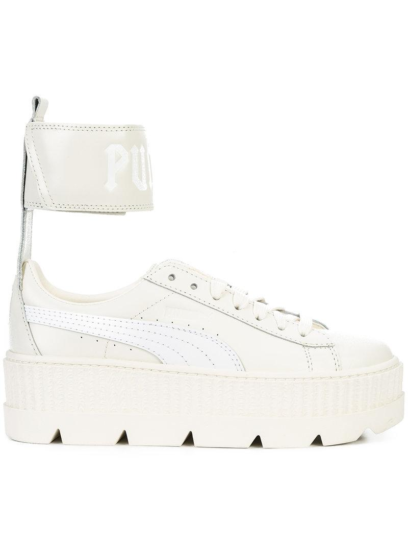 purchase cheap cf733 b878f Fenty Puma X Rihanna Women's Leather Ankle Strap Platform Sneakers in White