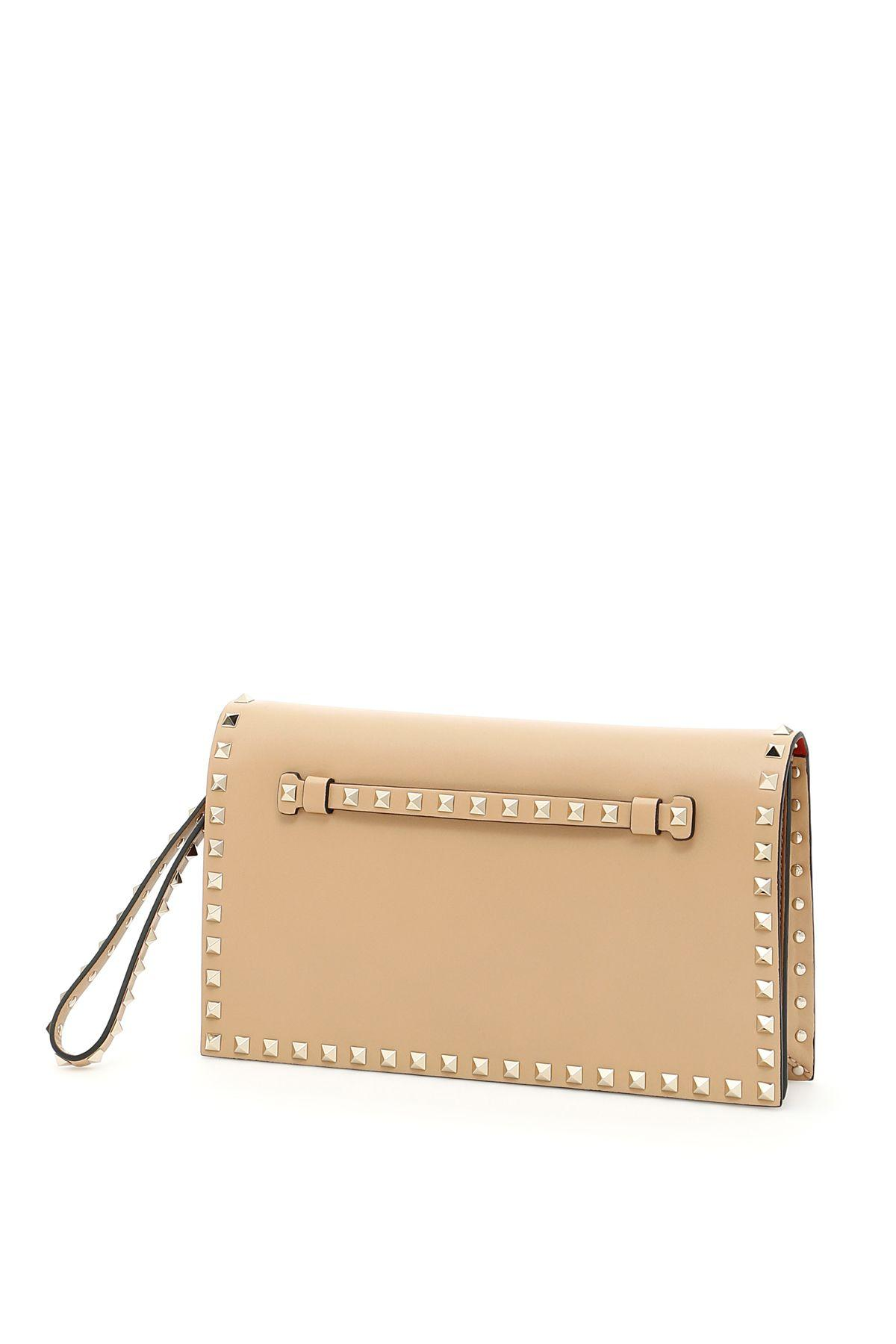 Valentino Garavani Rockstud Leather Clutch In Camel Rosebeige