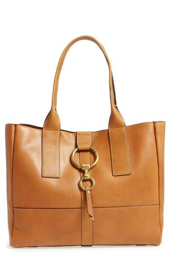 84da7f5f2 The floating suede zip pocket inside can also be unsnapped to carry on its  own as a minimalist clutch. Style Name: Frye Ilana Harness Leather Shopper.