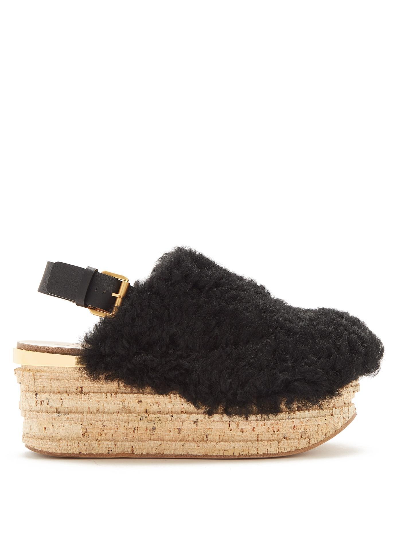 dec54111b1c ChloÉ Camilla Shearling Wedge Sandals In Black