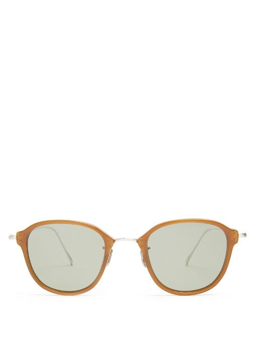 73c1c0e7f96 Since launching in 1972 Eyevan 7285 has worked towards creating stylish  sunglasses using expert Japanese craftsmanship. This brown transparent  acetate 746 ...