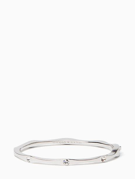4befdbe7427cb This undulating bangle with pave stones from our heavy metals collection is  lovely on its own or mixed in with your other wrist candy. Gold plated metal .