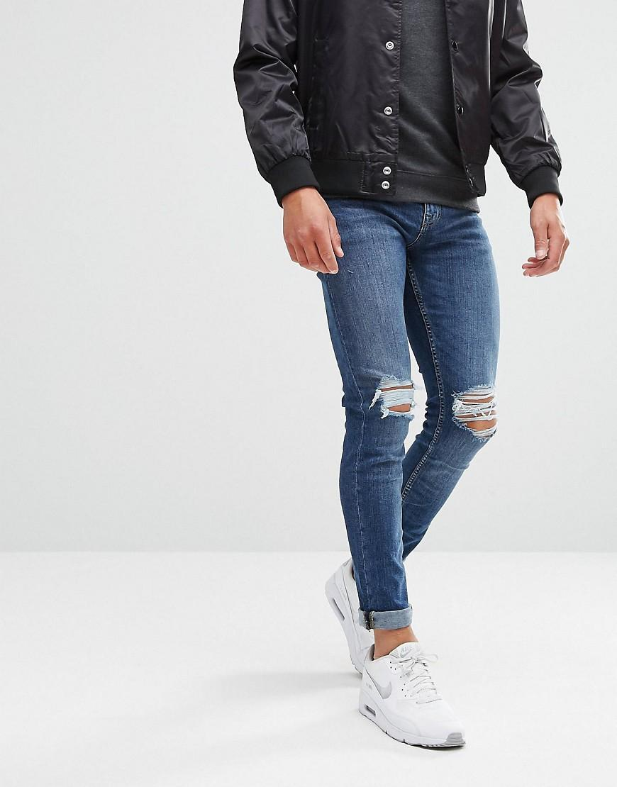 fdbda0a1d2f New Look Skinny Jeans With Knee Rip In Mid Blue Wash - Blue | ModeSens