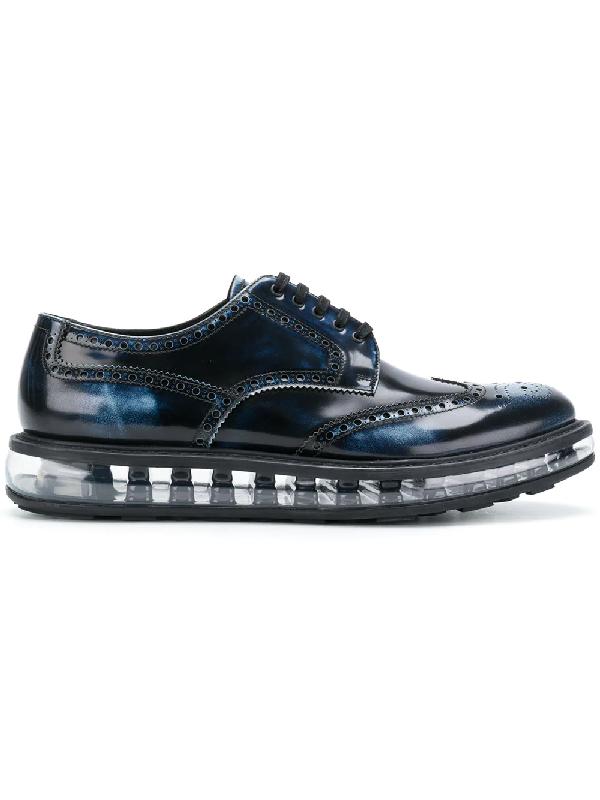 d570c4d22fa Prada Levitate Burnished-Leather Wingtip Brogues In Blue