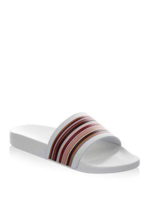 426c3d22a64 Paul Smith s followers will covet these white slides for the signature  stripe design across the strap. They re crafted from rubber with chunky  soles and ...