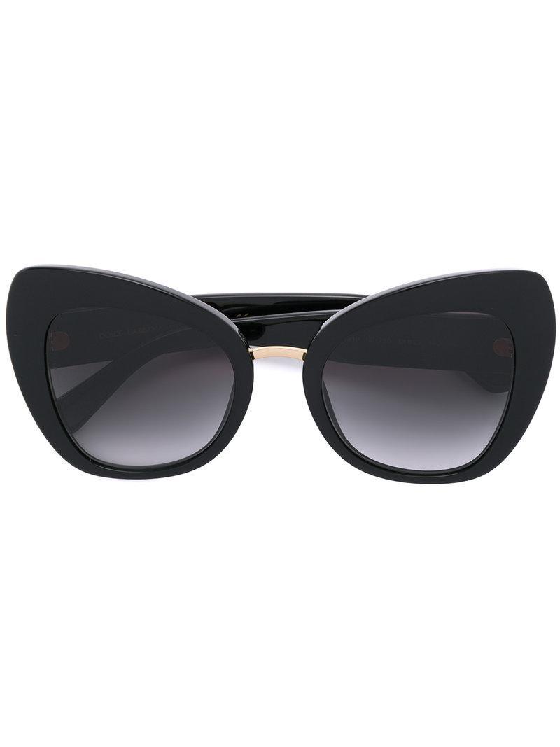 44a0e91298 Black acetate oversized cat-eye sunglasses from Dolce   Gabbana Eyewear  featuring gold-tone hardware