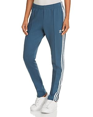 separation shoes fa1b3 4db8c Adidas Originals Sst Track Pants In Dark Teal
