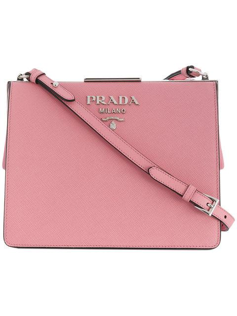 Fashioned in Italy from Prada s signature light pink Saffiano calf leather 4a77c4967a8df