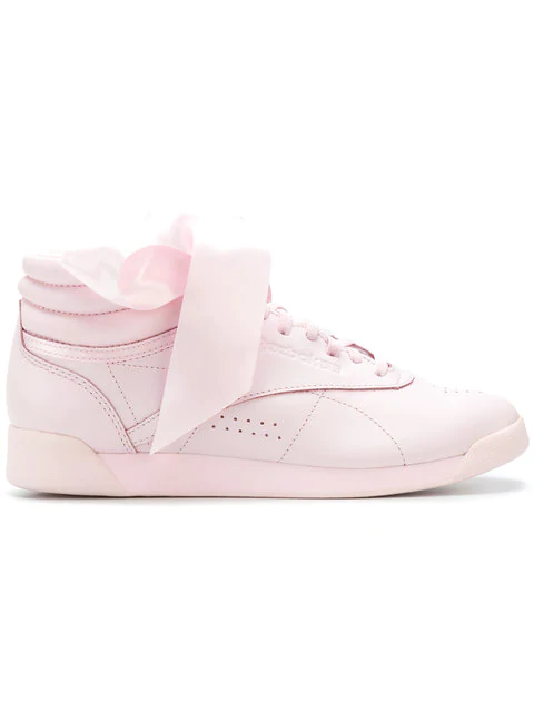 111a3fd1263 Reebok Freestyle Bow Leather High Top Sneakers In Pink