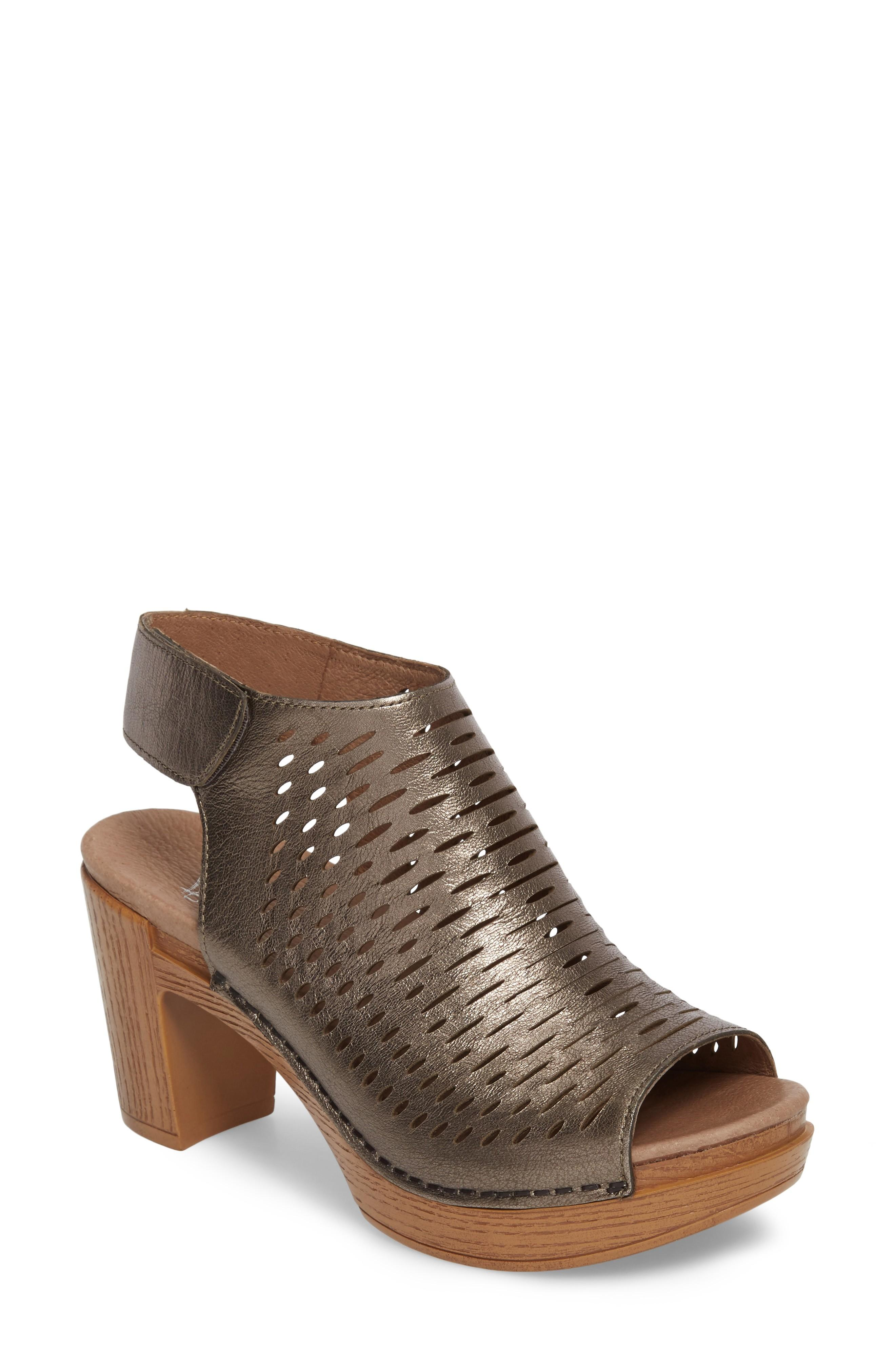 4125b3aa0bf A woodgrain block heel and rocker platform helps to propel your foot  forward naturally with every step you take in this chic sandal fashioned  with a breezy