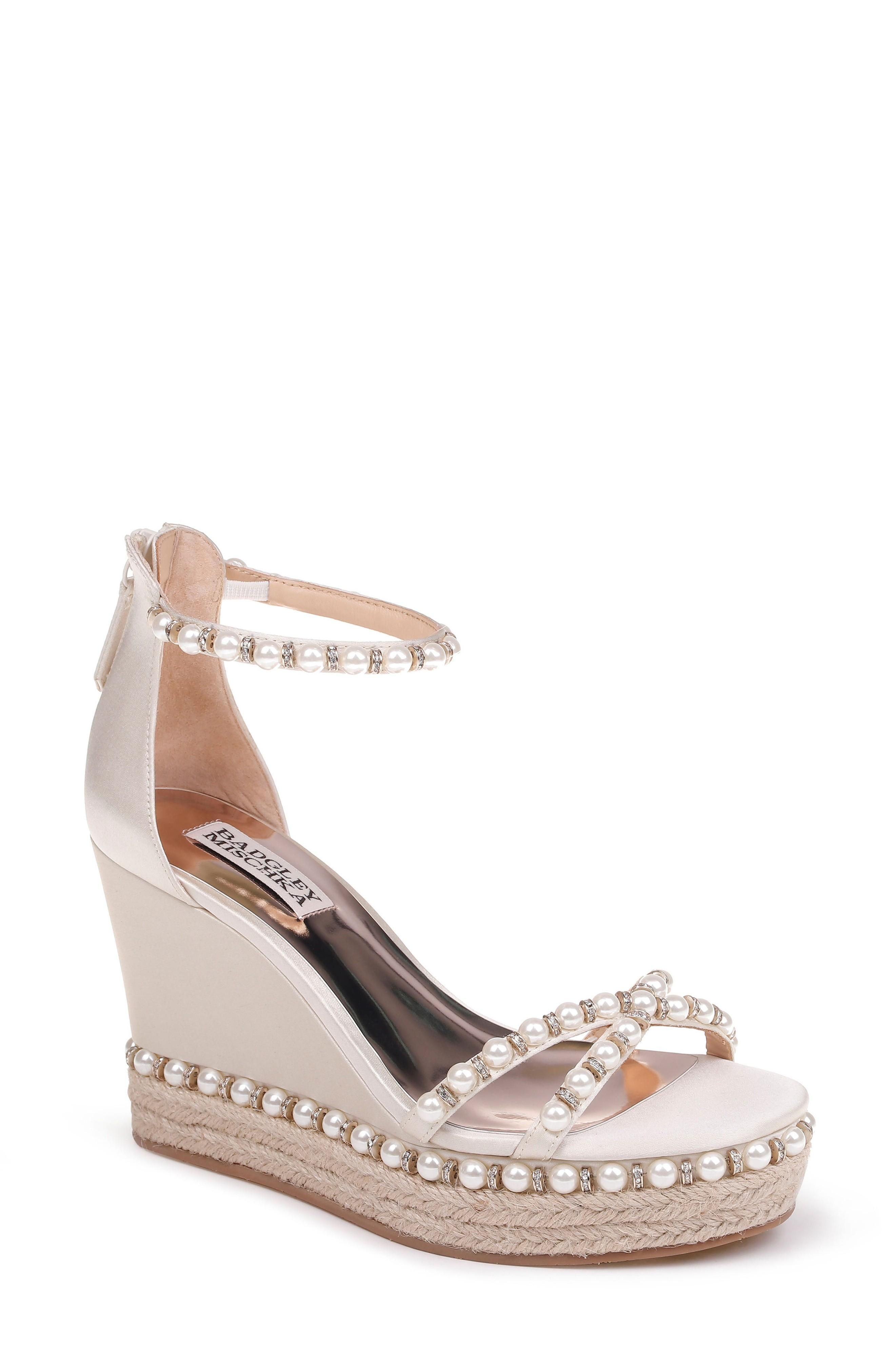 93de0c47506 An espadrille-wrapped sole and lustrous pearly beads with sparkling crystals  distinguish an eye-catching wedge secured by a slim strap that wraps around  the ...