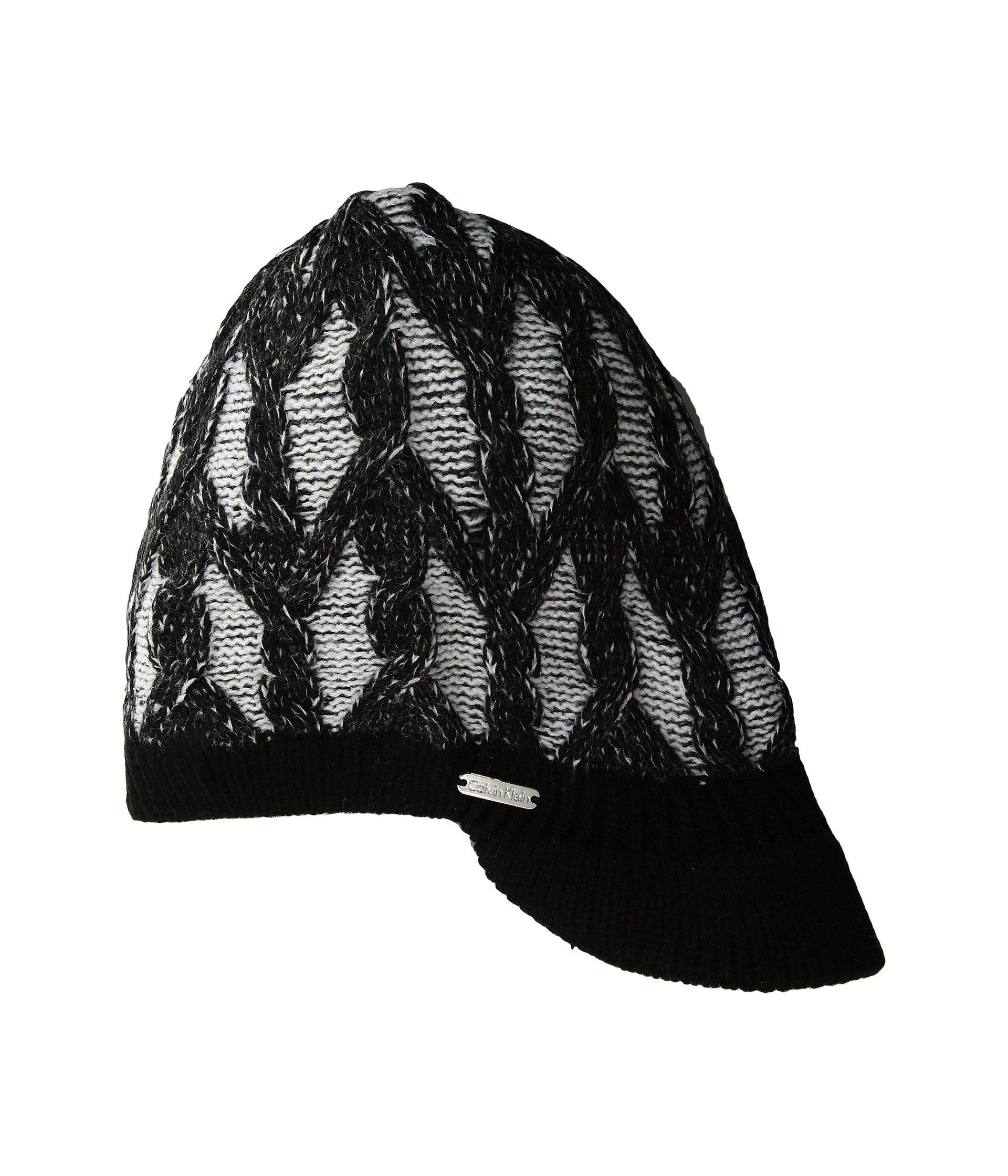 f7c4d032 Accentuate your trendsetting cool weather look with the Calvin Klein®  Plaited Cable Cabbie Hat. Cable knit cabbie hat. Signature logo-engraved  stud detail ...
