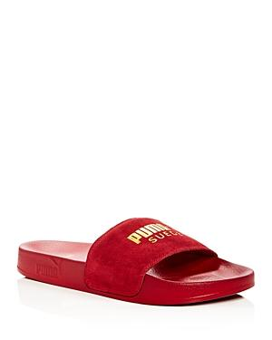 f87e24bf7aea Puma Men s Leadcat Suede Slide Sandals In Red Dahlia Gold Leather Suede.  SIZE   FIT INFORMATION