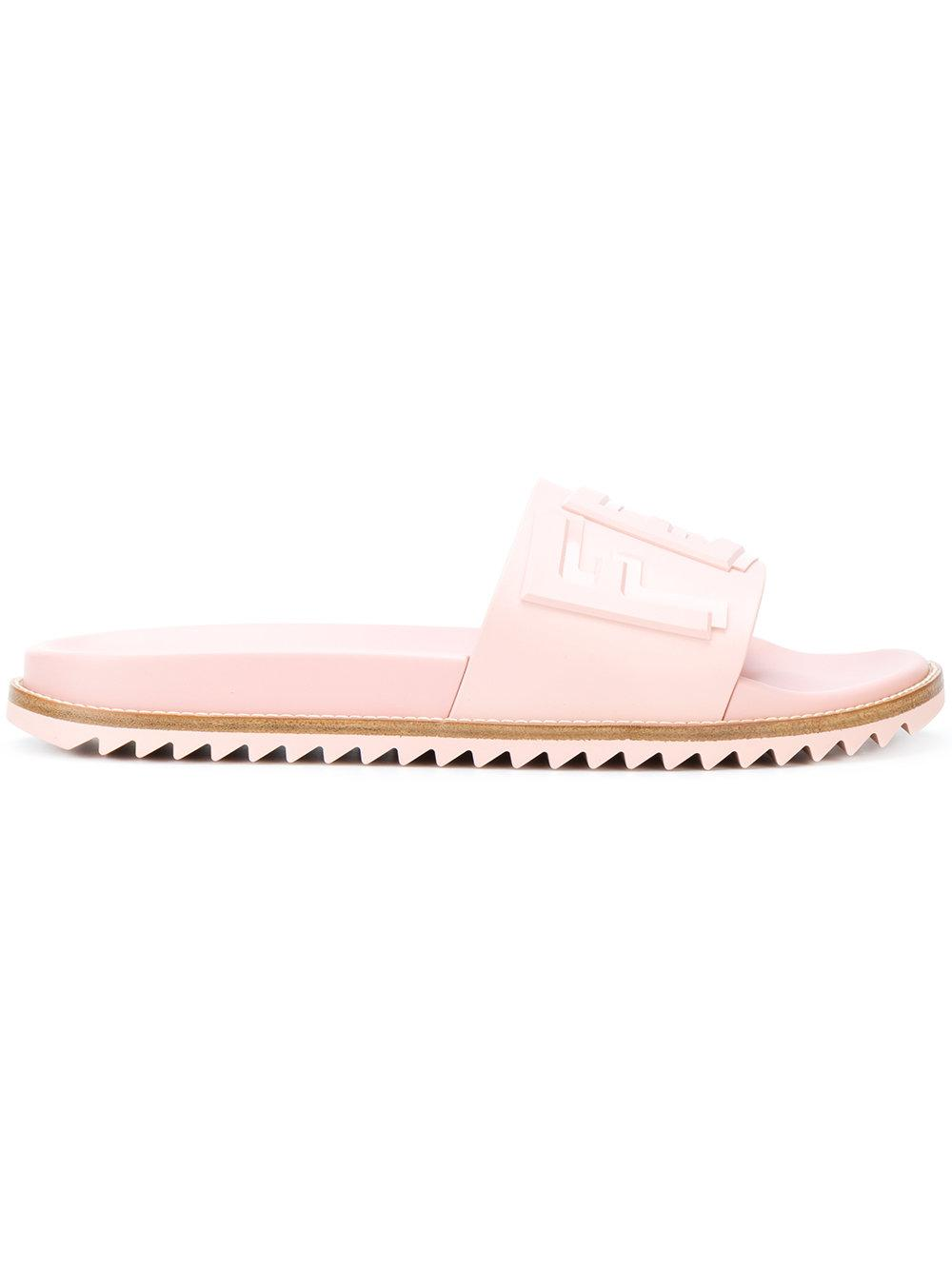 3fd5a92781b9d These pink logo embossed pool slides from Fendi featuring embossed  lettering across the ...