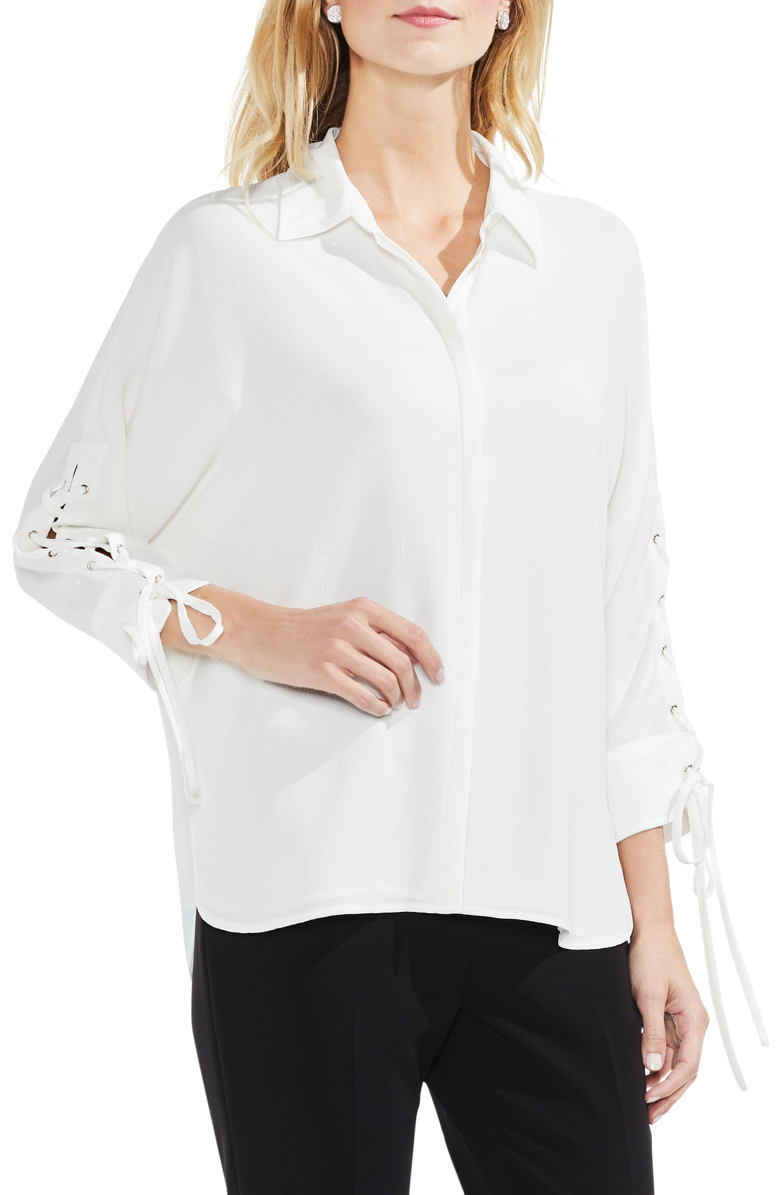 7dc24488e6a76 A breezy blouse cut from lightly textured crepe is updated with statement  sleeves partially laced up with fluttery ties. Style Name  Vince Camuto  Lace-Up ...