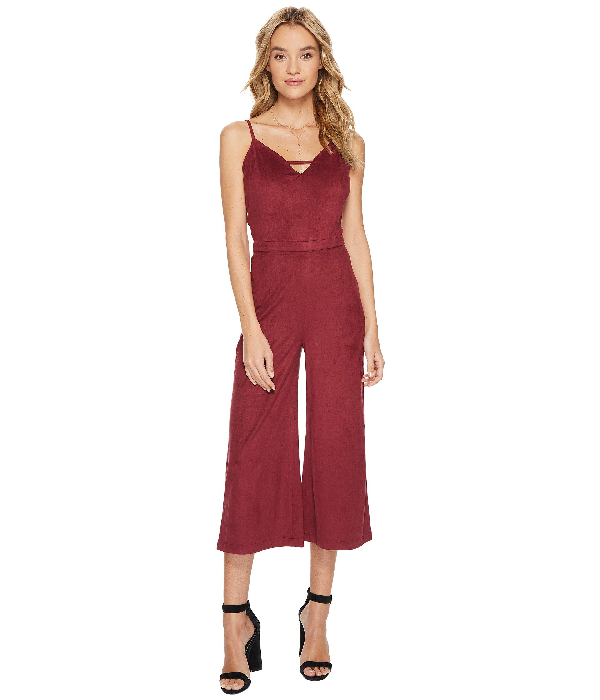 3562488c3794 A stylish jumpsuit for all the real fashionistas. Relaxed fit. Faux suede  fabrication. V-neckline. Adjustable spaghetti straps. Banded waist.