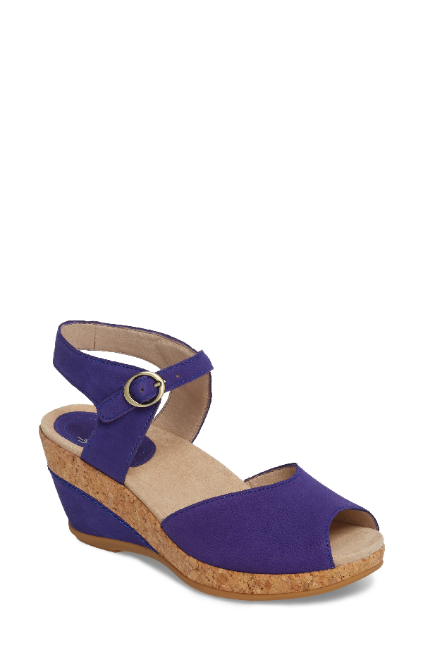 157a299ce1d An open toe and buckled ankle strap bring beautiful detailing to a  cork-wrapped wedge sandal styled with a contoured