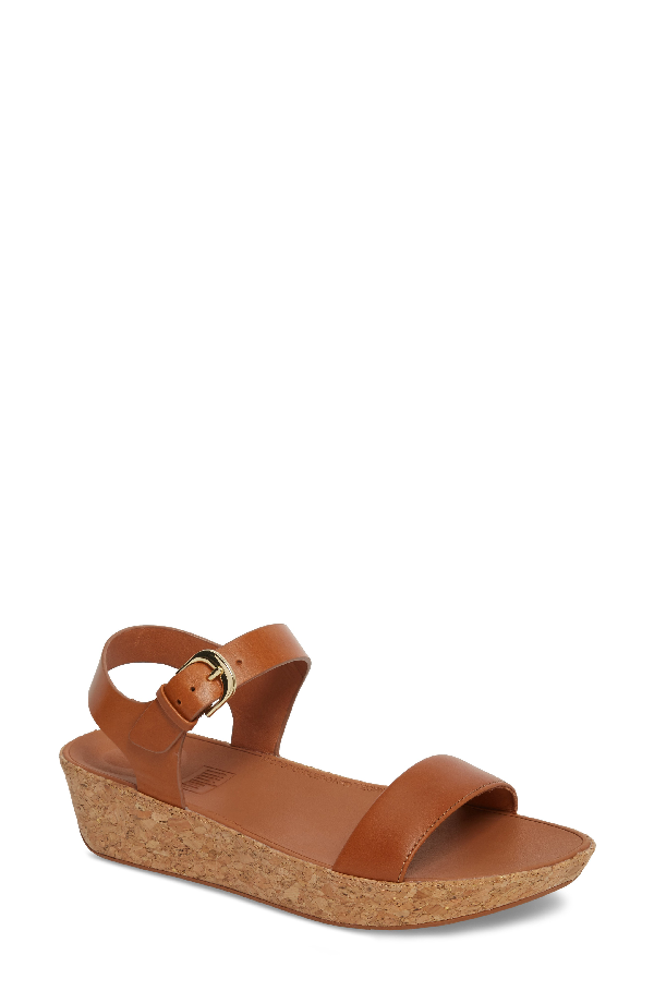 fdaed7224 A cushy sandal with minimalist straps and cork-wrapped wedge features a  patent-pending