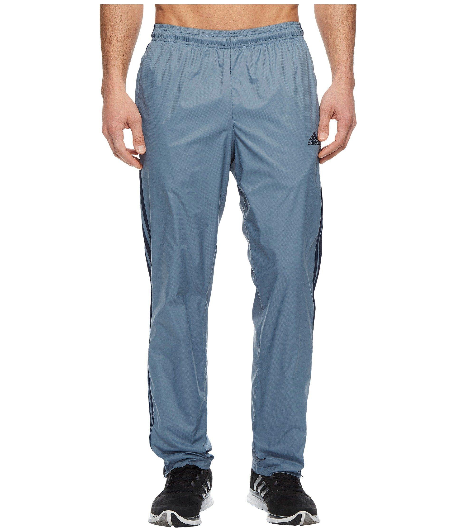 31a6e8a598fe ADIDAS ORIGINALS. Essentials 3S Wind Pants in Raw Steel Collegiate Navy