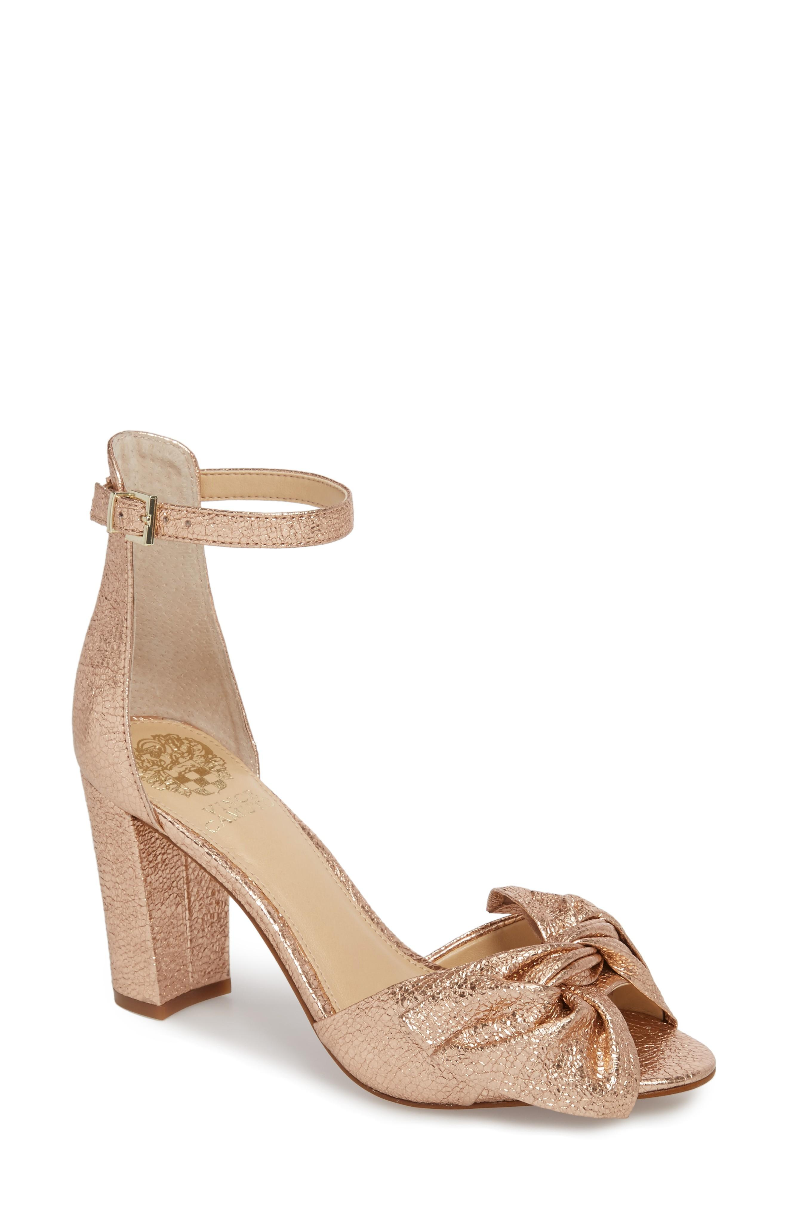 0237b04146f A knotted bow adds soft dimension to an otherwise minimalist strappy sandal  lofted by a wrapped block heel. Style Name  Vince Camuto Carrelen Block Heel  ...
